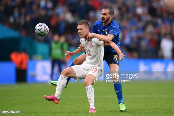 Dani Olmo of Spain battles for possession with Leonardo Bonucci of Italy during the UEFA Euro 2020 Championship Semi-final match between Italy and...
