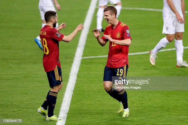 Dani Olmo of Spain celebrates 1-0 with Jordi Alba of Spain during the World Cup Qualifier match between Spain v Kosovo at the La Cartuja Stadium on...