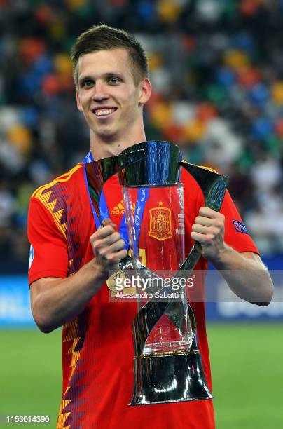 Dani Olmo of Spain celebrates the victory with the trophy at the end the 2019 UEFA U21 Final between Spain and Germanyat Stadio Friuli on June 30...