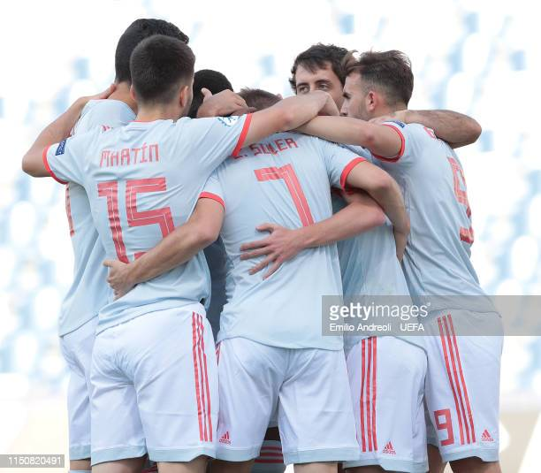 Dani Olmo of Spain celebrates with his teammates after scoring the opening goal during the 2019 UEFA U21 Group A match between Spain and Belgium at...