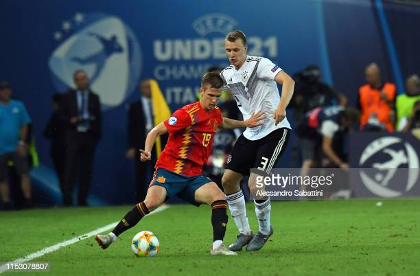 Dani Olmo of Spain competes for the ball with Lukas Klostermann of Germany during the 2019 UEFA U21 Final between Spain and Germany at Stadio Friuli...
