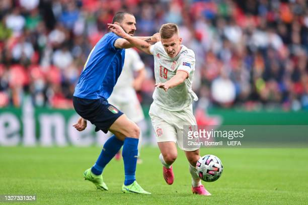 Dani Olmo of Spain looks to break away from Leonardo Bonucci of Italy during the UEFA Euro 2020 Championship Semi-final match between Italy and Spain...