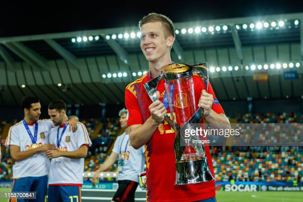 Dani Olmo of Spain with trophy after winning the 2019 UEFA U21 Final between Spain and Germany at Stadio Friuli on June 30 2019 in Udine Italy