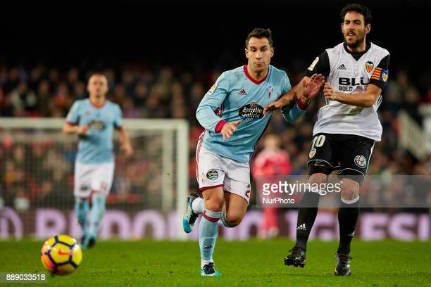 Dani Parejo of Valencia CF competes for the ball with Hugo Mallo of Real Club Celta de Vigo during the La Liga game between Valencia CF and Real Club...