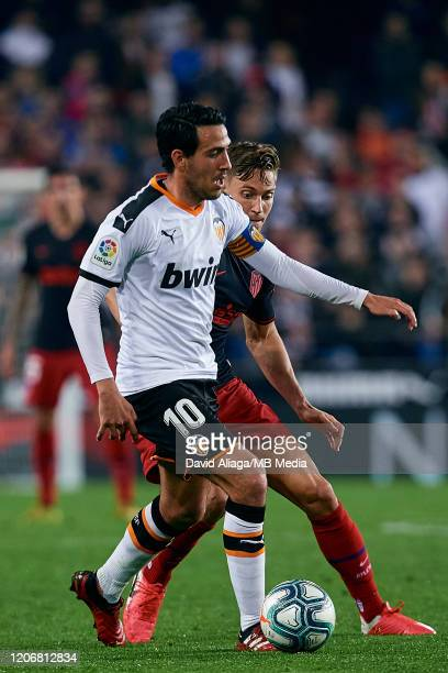 Dani Parejo of Valencia CF competes for the ball with Marcos Llorente of Atletico de Madrid during the Liga match between Valencia CF and Club...