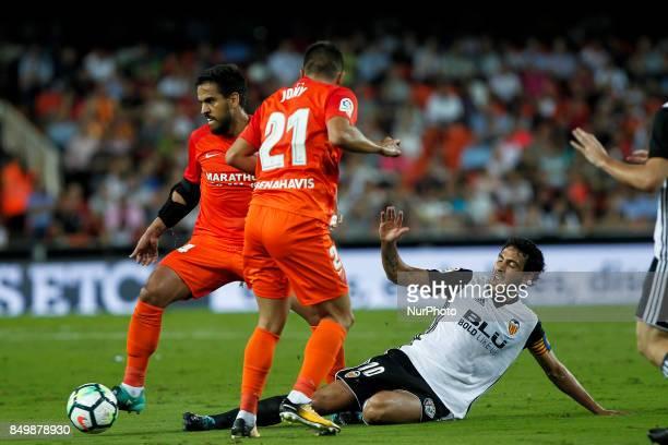 10 Dani Parejo of Valencia CF in action against 14 Jose Luis Garcia del Pozo Recio of Malaga CF during spanish La Liga match between Valencia CF vs...