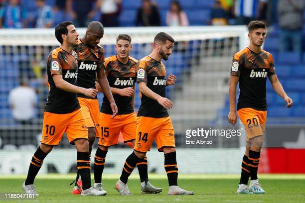 Dani Parejo of Valencia CF Jose Garay of Valencia CF Ferran Torres of Valencia CF leaves the pitch after the victory against RCD Espanyol during the...