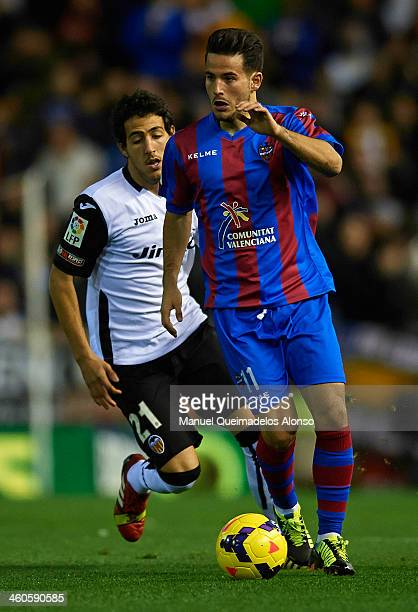 Dani Parejo of Valencia competes for the ball with Ruben Garcia of Levante during the La Liga match between Valencia CF and Levante UD at Estadio...