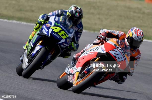 Dani Pedrosa of Repsol Honda Team leads Valentino Rossi of Movistar Yamaha MotoGP team during MotoGP of San Marino race at Misano World Circuit on...