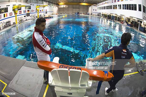 Dani Pedrosa of Spain and Repsol Honda Team and Andrea Iannone of Italy and Ducati Team pose in the pool during the preevent 'MotoGP Riders Visit The...