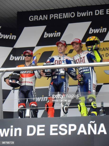 Dani Pedrosa of Spain and Repsol Honda Team and Jorge Lorenzo of Spain and Fiat Yamaha Team and Valentino Rossi of Italy and Fiat Yamaha Team...