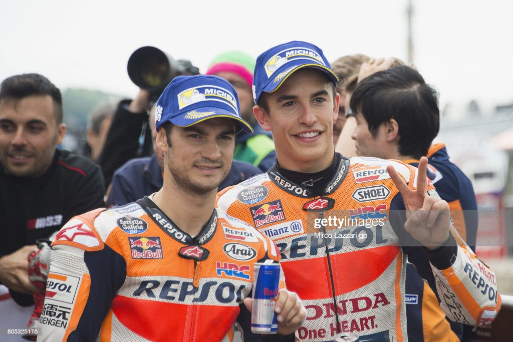 Dani Pedrosa of Spain and Repsol Honda Team (L) and Marc Marquez of Spain and Repsol Honda Team celebrate at the end of the qualifying practice during the MotoGp of Germany - Qualifying at Sachsenring Circuit on July 1, 2017 in Hohenstein-Ernstthal, Germany.