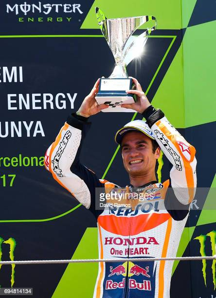 Dani Pedrosa of Spain and Repsol Honda Team celebrates on the podium after finishing third the MotoGp of Catalunya at Circuit de Catalunya on June 11...