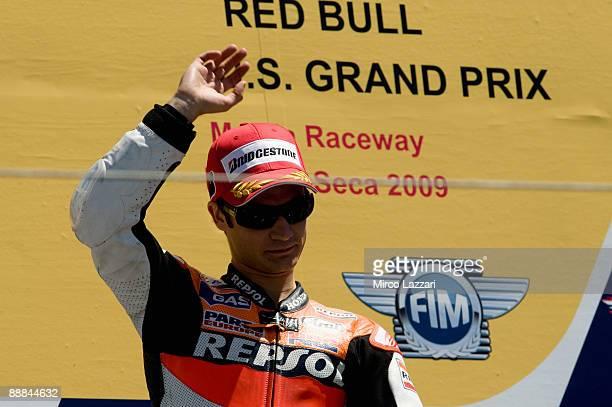 Dani Pedrosa of Spain and Repsol Honda Team celebrates victory on the podium during the Moto GP U S Grand Prix at the Mazda Raceway Laguna Seca on...