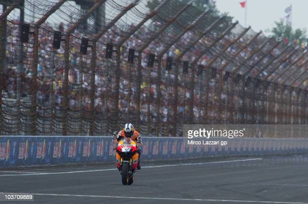 Dani Pedrosa of Spain and Repsol Honda Team cuts the finish lane and celebrates the victory at the end of MotoGP race of the Red Bull Indianapolis...