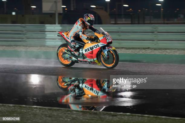 Dani Pedrosa of Spain and Repsol Honda Team heads down a straight and test the wet track during the Moto GP Testing Qatar at Losail Circuit on March...