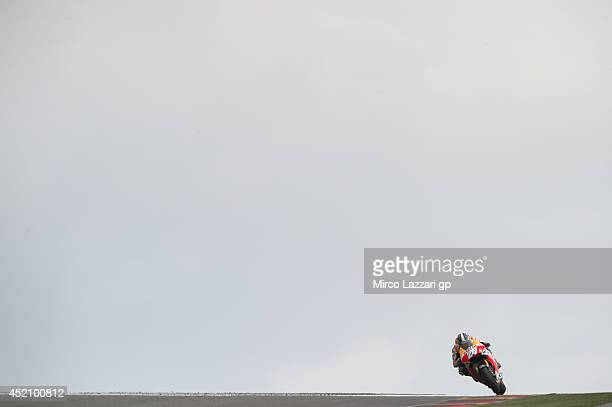 Dani Pedrosa of Spain and Repsol Honda Team heads down a straight during the MotoGP race during the MotoGp of Germany Race at Sachsenring Circuit on...