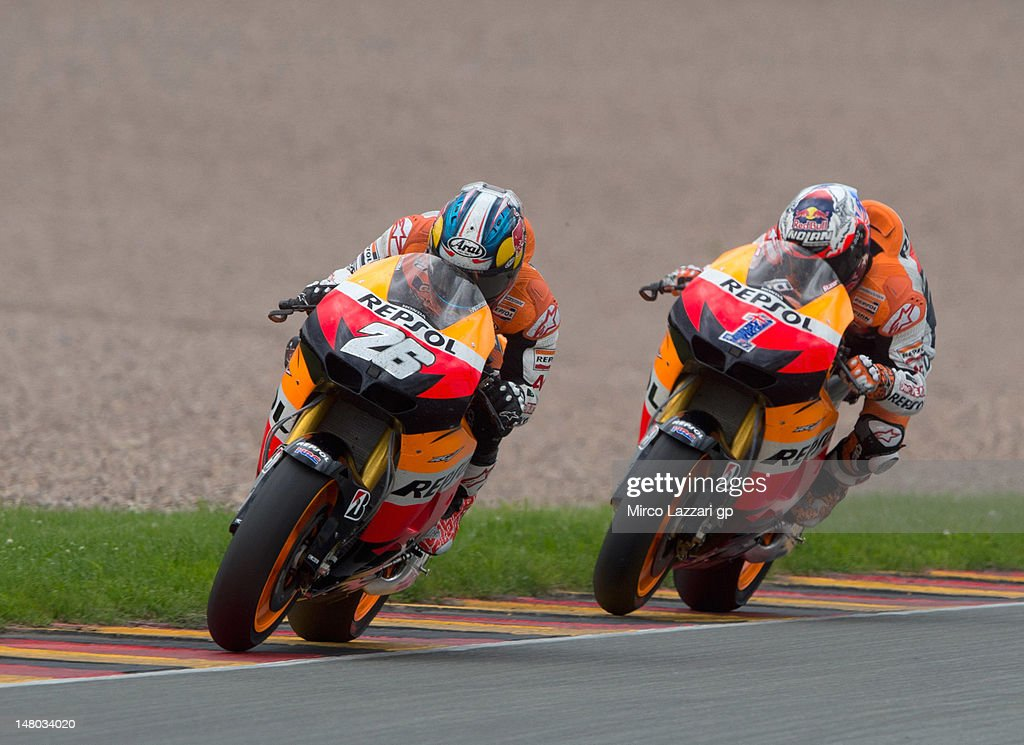 Dani Pedrosa of Spain and Repsol Honda Team leads Casey Stoner of Australia and Repsol Honda Team during the MotoGP race of the MotoGp of Germany at Sachsenring Circuit on July 8, 2012 in Hohenstein-Ernstthal, Germany.