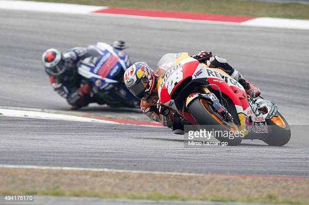 Dani Pedrosa of Spain and Repsol Honda Team leads Jorge Lorenzo of Spain and Movistar Yamaha MotoGP during the MotoGP race during the MotoGP Of...