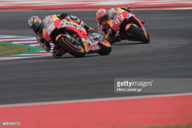 Dani Pedrosa of Spain and Repsol Honda Team leads Marc Marquez of Spain and Repsol Honda Team during the qualifying practice during the MotoGp of...
