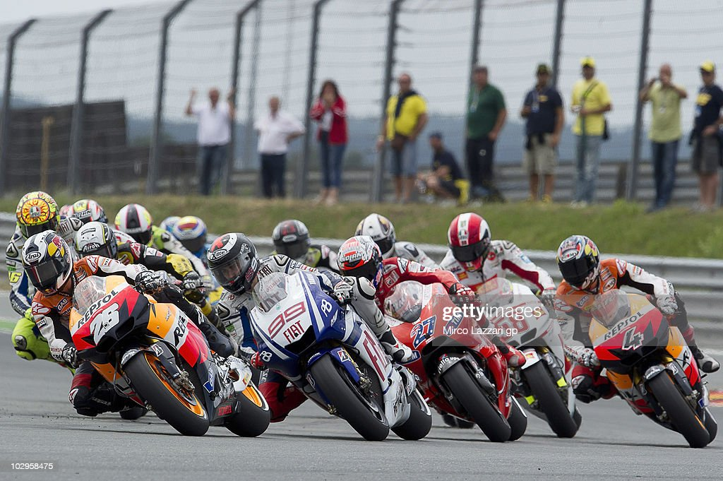 Dani Pedrosa of Spain and Repsol Honda Team leads the field in the first corner of first lap during the MotoGP race of Grand Prix of Germany at Sachsenring Circuit on July 18, 2010 in Hohenstein-Ernstthal, Germany.