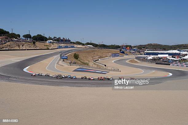 Dani Pedrosa of Spain and Repsol Honda Team leads the group in the first corner of the first lap during the Moto GP U S Grand Prix at the Mazda...