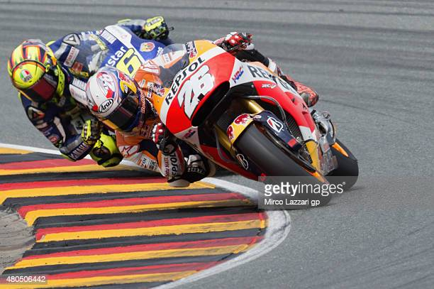 Dani Pedrosa of Spain and Repsol Honda Team leads Valentino Rossi of Italy and Movistar Yamaha MotoGP during the MotoGP race during the MotoGp of...