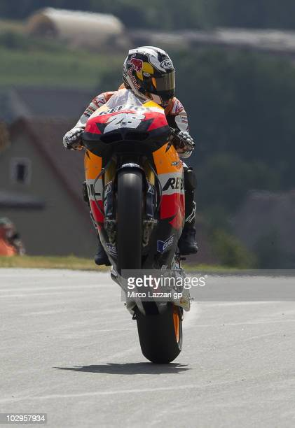 Dani Pedrosa of Spain and Repsol Honda Team lifts the front wheel and celebrates the victory at the end of the MotoGP race of Grand Prix of Germany...