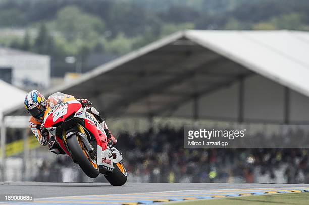 Dani Pedrosa of Spain and Repsol Honda Team lifts the front wheel during the qualifying practice of the MotoGp Of France Qualifying on May 18 2013 in...
