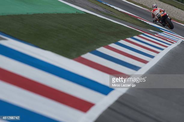 Dani Pedrosa of Spain and Repsol Honda Team rounds the bend during the MotoGP Netherlands Free Practice at on June 26 2014 in Assen Netherlands