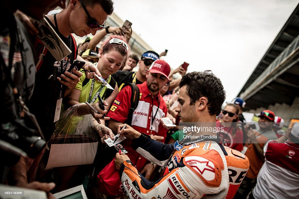 Dani Pedrosa # 26 of Spain and Repsol Honda Team signs autographs after the MotoGP Qualifiers at Indianapolis Motor Speedway on August 08, 2015 in Indianapolis, Indiana.