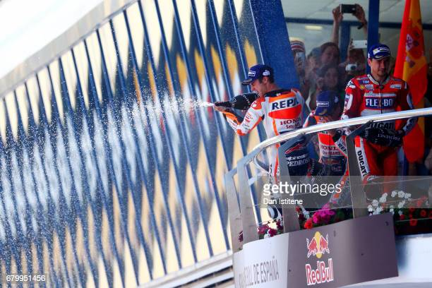 Dani Pedrosa of Spain and the Repsol Honda Team celebrates on the podium next to Jorge Lorenzo of Spain and the Ducati Team after winning the MotoGP...