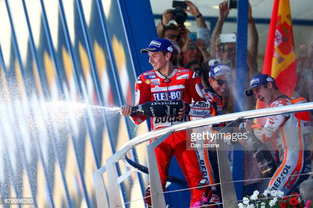 Dani Pedrosa of Spain and the Repsol Honda Team celebrates on the podium with Jorge Lorenzo of Spain and the Ducati Team and Marc Marquez of Spain...