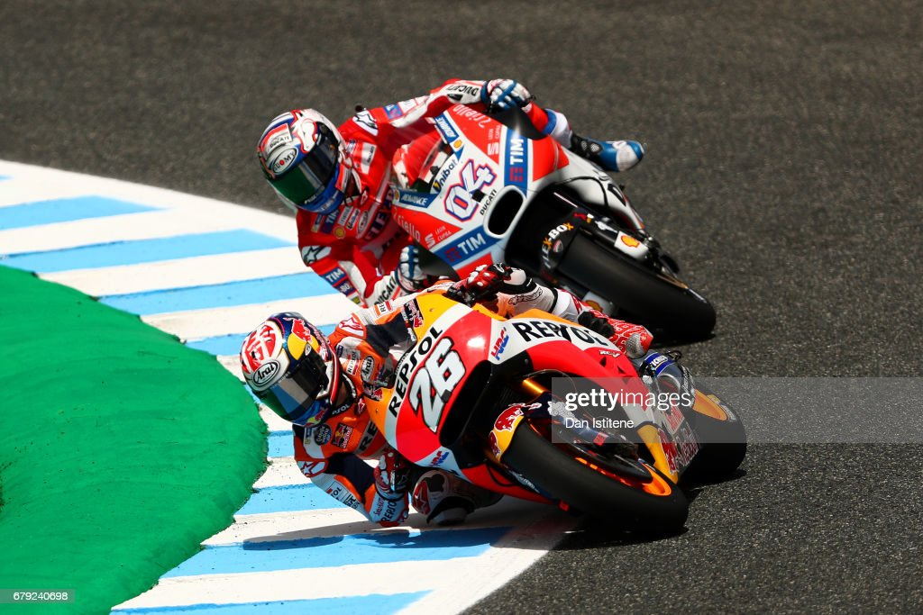 Dani Pedrosa of Spain and the Repsol Honda Team rides ahead of Andrea Dovizioso of Italy and the Ducati Team during free practice for the MotoGP of Spain at Circuito de Jerez on May 5, 2017 in Jerez de la Frontera, Spain.