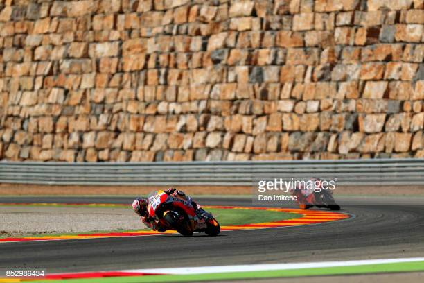 Dani Pedrosa of Spain and the Repsol Honda Team rides ahead of Jorge Lorenzo of Spain and the Ducati Team during the MotoGP of Aragon at Motorland...