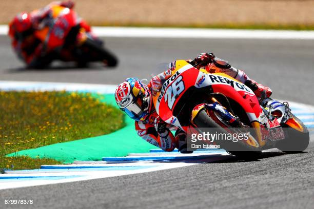 Dani Pedrosa of Spain and the Repsol Honda Team rides ahead of Marc Marquez of Spain and the Repsol Honda Team during the MotoGP of Spain at Circuito...