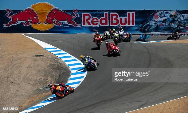 Dani Pedrosa of Spain leads the field at the start of the Moto GP Red Bull U S Grand Prix at the Mazda Raceway Laguna Seca on July 5 2009 in Monterey...