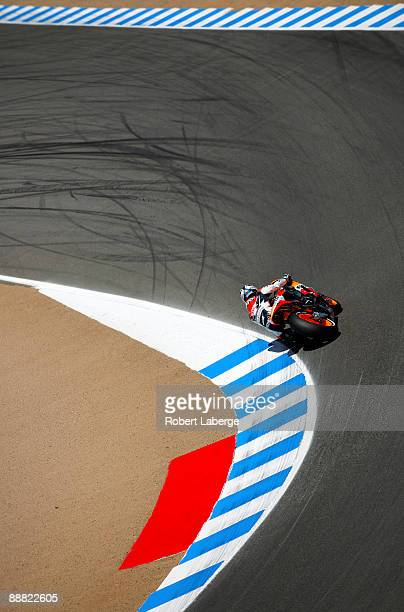 Dani Pedrosa of Spain rides the Repsol Honda during qualifying for the Moto GP Red Bull U S Grand Prix at the Mazda Raceway Laguna Seca on July 4...