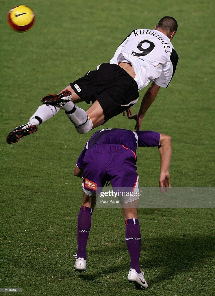 Dani Rodrigues of the Knights collides with Simon Colosimo of the Glory during the round seven Hyundai A-League match between Perth Glory and the New Zealand Knights at Members Equity Stadium October 6, 2006 in Perth, Australia.