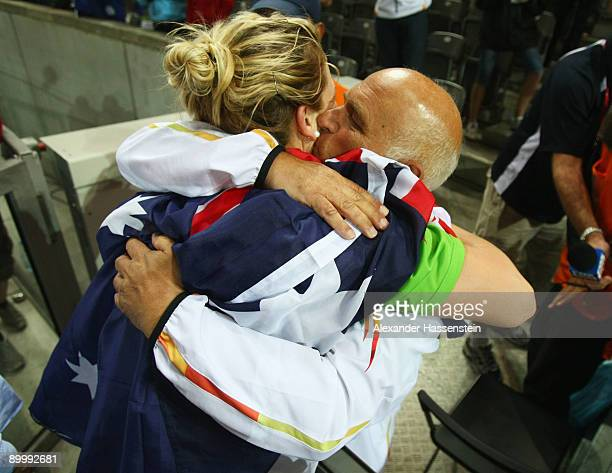 Dani Samuels of Australia celebrates winning the gold medal in the women's Discus Throw Final with Coach Denis Knowles during day seven of the 12th...