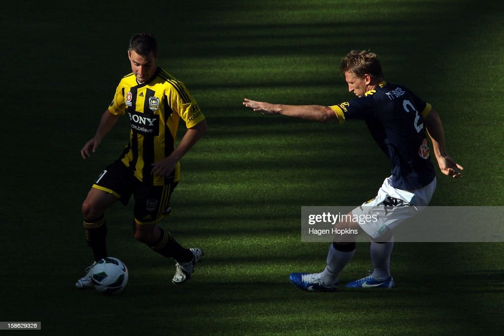 Dani Sanchez of the Phoenix controls the ball under pressure from Daniel McBreen of the Mariners during the round 12 A-League match between the Wellington Phoenix and the Central Coast Mariners at Westpac Stadium on December 22, 2012 in Wellington, New Zealand.