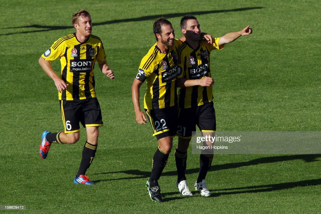 Dani Sanchez (R) of the Phoenix is congratulated on his goal by teammate Andrew Durante while Alexander Smith looks on during the round 12 A-League match between the Wellington Phoenix and the Central Coast Mariners at Westpac Stadium on December 22, 2012 in Wellington, New Zealand.