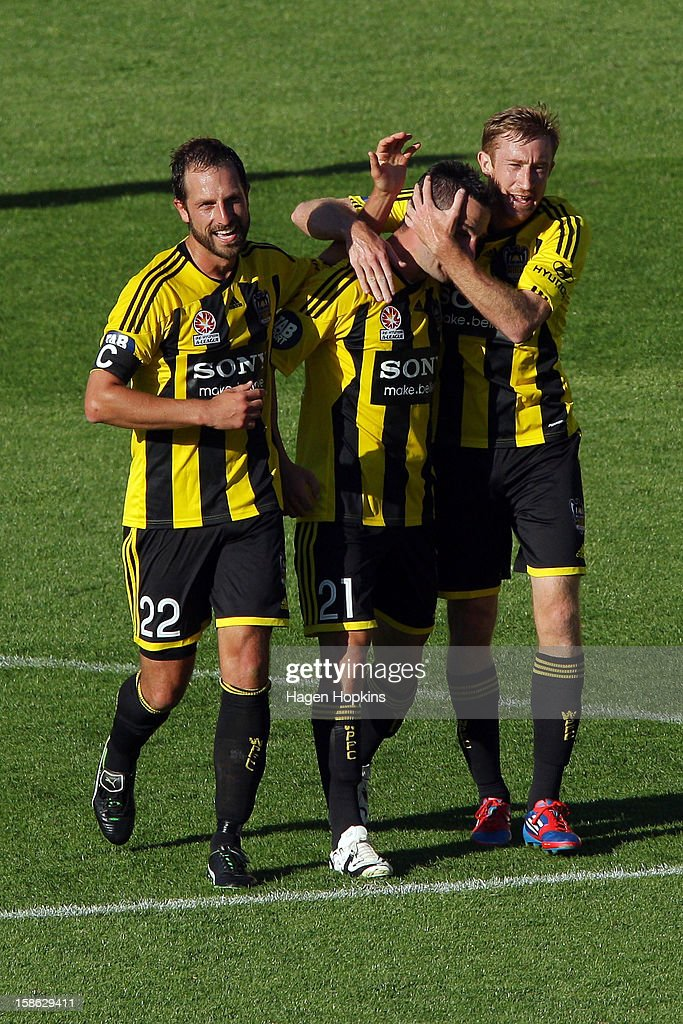 Dani Sanchez of the Phoenix is congratulated on his goal by teammates Andrew Durante (L) and Alexander Smith (R) during the round 12 A-League match between the Wellington Phoenix and the Central Coast Mariners at Westpac Stadium on December 22, 2012 in Wellington, New Zealand.