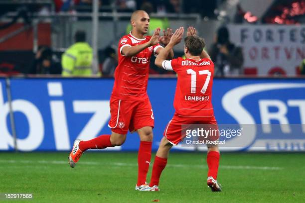 Dani Schahin celebrates the first goal with Andreas Lambertz of Duesseldorf during the Bundesliga match between Fortuna Duesseldorf and FC Schalke 04...
