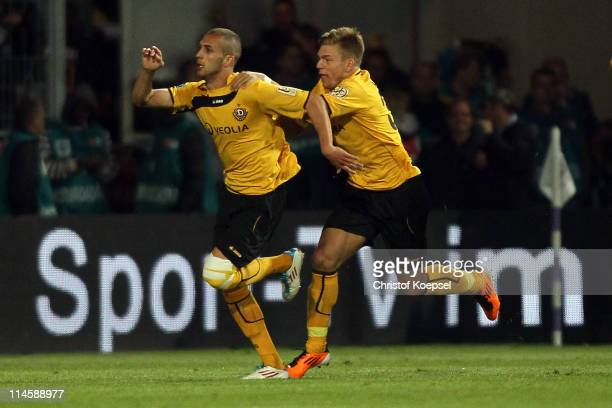 Dani Schahin of Dresden celebrates the second goal with Alexander Esswein of Dresden during the Second Bundesliga playoff second leg match between...