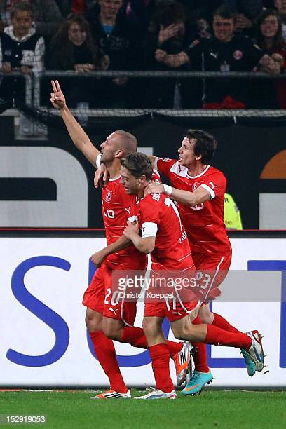 Dani Schahin of Duesseldorf celebrates the second goal with Andreas Lambertz and Robbie Kruse during the Bundesliga match between Fortuna Duesseldorf...