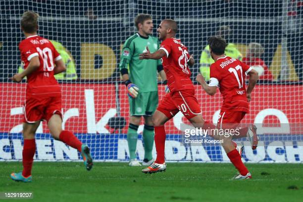Dani Schahin of Duesseldorf celebrates the second goal with Ken Ilsoe and Andreas Lambertz and Lars Unnerstall of Schalke looks dejected during the...