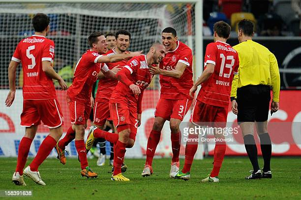 Dani Schahin of Duesseldorf celebrates with teammates after heading his team's first goal during the Bundesliga match between Fortuna Duesseldorf...