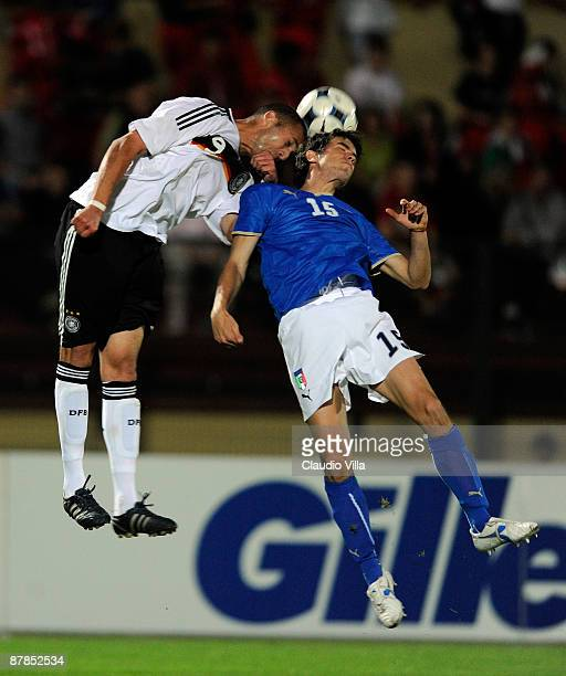 Dani Schahin of Germany and Giovanni Rossi of Italy go up for a header during the friendly match between Italy and Germany at Vittorio Pozzo stadium...