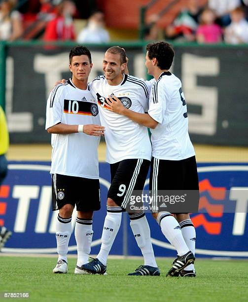 Dani Schahin of Germany celebrates with team mates during the friendly match between Italy and Germany at Vittorio Pozzo stadium on May 19, 2009 in...